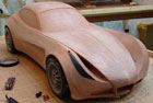 1/4 scale automotive clay sculpt of a kit car concept in progress
